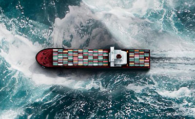 aerial view of a container ship in rough seas